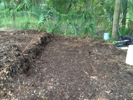 The mulch has been moved and this section is now compliant.