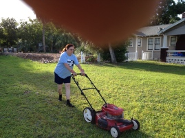 Karen mowing the north side. Nice finger!